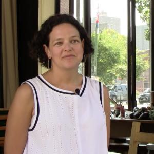 Naama Tamir, standing in her restaurant